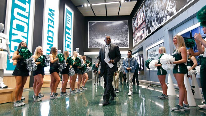 Mel Tucker, Michigan State's new football coach, enters a news conference Wednesday, Feb. 12, 2020, in East Lansing, Mich.