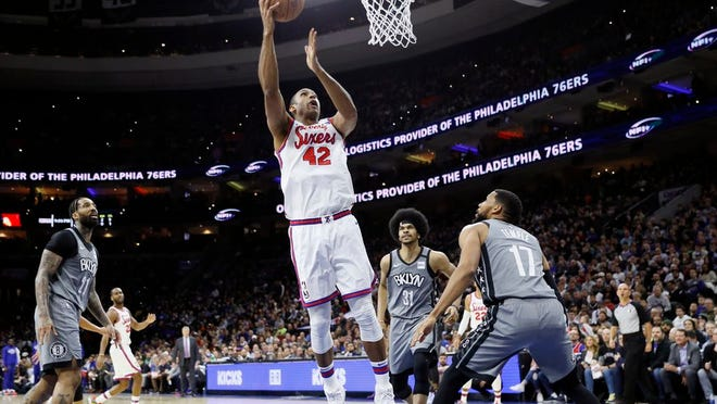 76ers' Al Horford (42) drives to the basket against Nets' Garrett Temple (17) during the first half.