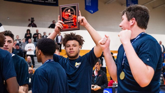 Marlboro's CJ Faircloth holds up the plaque as the basketball team celebrate their win over Chester during the section 9 class B basketball championship game at Mount Saint Mary College in Newburgh, NY on Friday, March 6th, 2020. KELLY MARSH/FOR THE TIMES HERALD-RECORD
