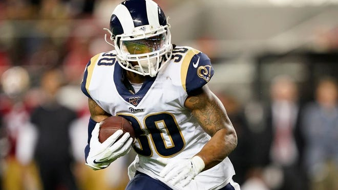 From Dec. 21, 2019, Los Angeles Rams running back Todd Gurley II carries against the San Francisco 49ers during the first half of an NFL football game in Santa Clara, Calif.  The Los Angeles Rams have released running back Todd Gurley, their superstar running back with a massive contract and a troubling injury history. The Rams made the move Thursday, March 19, 2020 several minutes before roughly $10 million in the three-time Pro Bowl selection's contract became fully guaranteed.