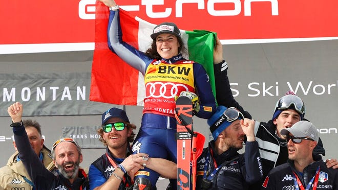 Italy's Federica Brignone celebrates winning an alpine ski, women's World Cup alpine combined, in Crans Montana, Switzerland, Sunday, Feb. 23, 2020.