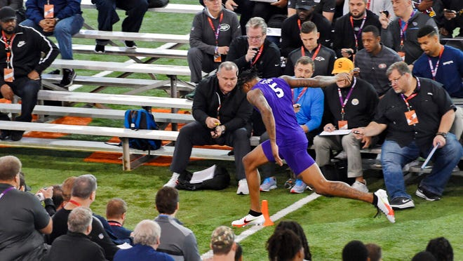 Clemson football player Tee Higgins runs the 40-yard dash during NFL Pro Day Thursday, March 12, 2020, in Clemson, S.C.