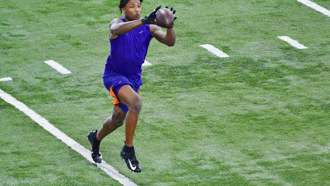 Clemson football player Tee Higgins catches a pass during NFL Pro Day Thursday, March 12, 2020, in Clemson, S.C.
