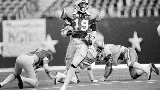 From Nov. 7, 1981, SMU's Eric Dickerson (19) runs the ball against against Rice during the first half of an during an NCAA college football game at Texas Stadium in Irving, Texas. Dickerson, Heisman Trophy winner Eric Crouch from Nebraska and the late Steve McNair from Alcorn State are among 17 players selected for induction into the College Football Hall of Fame on Wednesday, March 11, 2020.