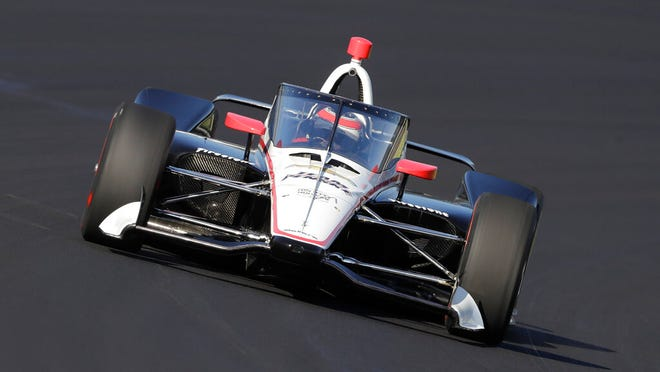 From Oct. 2, 2019, Will Power, of Australia, drives into turn one during the Aeroscreen testing at Indianapolis Motor Speedway in Indianapolis. After 10 months of testing, the canopy-shaped cockpit protection is intended to protect the driver from debris.