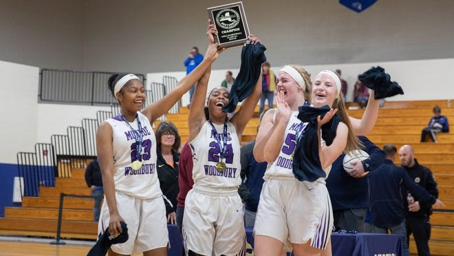 Monroe-Woodbury girls basketball players celebrate their victory over Valley Central in the Section 9 Class AA championship on March 7, 2020