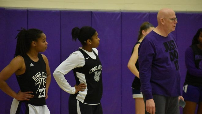 Taylor Neely and Toni Neeley watch coach Dave Powers at a recent Monroe-Woodbury practice.