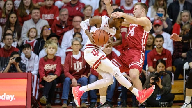Indiana guard Al Durham, left, drives into Wisconsin guard Brad Davison in the second half of an NCAA college basketball game in Bloomington, Ind., Saturday, March 7, 2020. Wisconsin won 60-56.