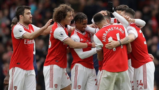 Arsenal's players celebrate a goal during the Premier League soccer match between Arsenal and West Ham at the Emirates Stadium in London, Saturday, March 7, 2020.