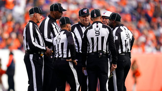 "In this Nov. 3, 2019, file photo, officials discuss a call during the first half of an NFL football game between the Cleveland Browns and the Denver Broncos in Denver. Two teams have suggested changes to game officiating, including a ""sky judge"" utilized by colleges, among seven rules proposals that will be presented to team owners later this month."