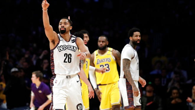 Brooklyn Nets' Spencer Dinwiddie (26) lobbies for a call to go in his team's favor during the second half of an NBA basketball game against the Los Angeles Lakers Tuesday, March 10, 2020, in Los Angeles.
