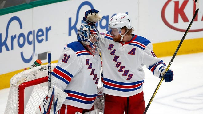 New York Rangers goaltender Igor Shesterkin (31) gets congratulations from defenseman Marc Staal (18) after the Rangers defeated the Dallas Stars 4-2 in an NHL hockey game in Dallas, Tuesday, March 10, 2020.