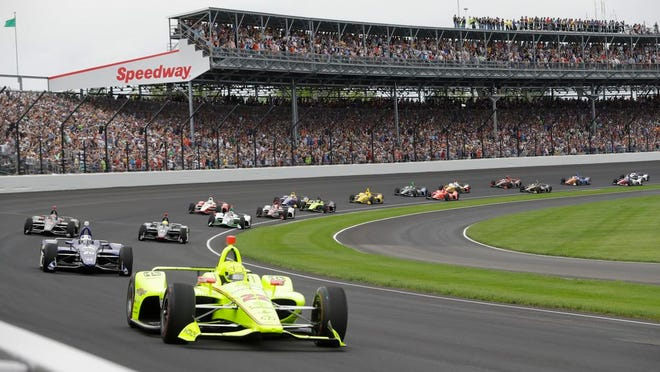 From May 26, 2019, Simon Pagenaud, of France, leads the field through the first turn on the start of the Indianapolis 500 IndyCar auto race at Indianapolis Motor Speedway, in Indianapolis. The Indianapolis 500 scheduled for May 24 has been postponed until August because of the coronavirus pandemic and won't run on Memorial Day weekend for the first time since 1946. The race will instead be held Aug. 23.