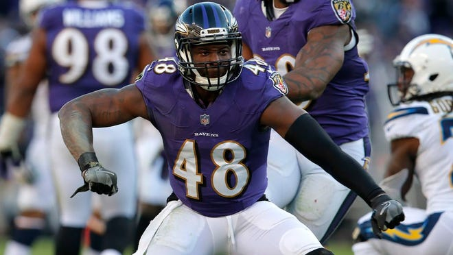 From Jan. 6, 2019, Baltimore Ravens inside linebacker Patrick Onwuasor celebrates after a play in the second half of an NFL wild card playoff football game against the Los Angeles Chargers in Baltimore.  A person with direct knowledge of the deal says the New York Jets and linebacker Patrick Onwuasor have agreed to terms on a one-year contract, Wednesday, March 25, 2020.  Onwuasor played his first four NFL seasons in Baltimore and was once considered the heir apparent to C.J. Mosley with the Ravens. Now, the two are teammates again in New York.