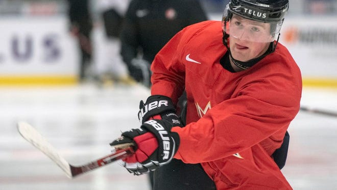 From Jan. 1, 2020, Canada's Alexis Lafreniere shoots during the team's practice at the World Junior Hockey Championships in Ostrava, Czech Republic. Lafrenière has nothing to do but wait now that his Canadian junior hockey season is over, and uncertainty over when the NHL draft will take place as a result of the new coronavirus.