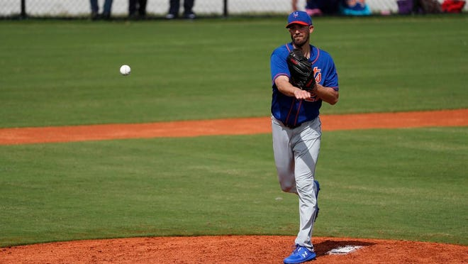 New York Mets pitcher Rick Porcello throws to first during spring training baseball practice Saturday, Feb. 15, 2020, in Port St. Lucie, Fla.
