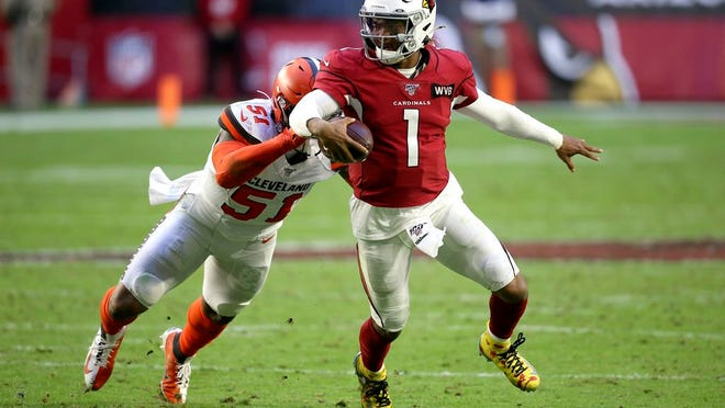From Dec. 15, 2019, Arizona Cardinals quarterback Kyler Murray (1) gets away from Cleveland Browns linebacker Mack Wilson (51) during the second half of an NFL football game in Glendale, Ariz. Coach Kliff Kingsbury and the Cardinals went 5-10-1 last year, but they're a popular pick to improve sharply this year.