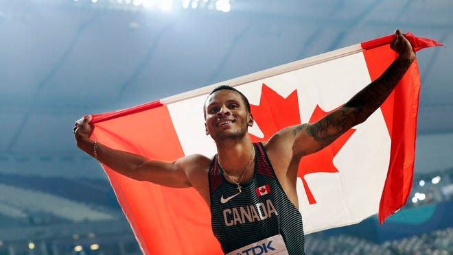 From Oct. 1, 2019, Canada's Andre De Grasse celebrates after winning the silver medal in the men's 200-meters at the World Athletics Championships in Doha, Qatar. Stunned at first, sprinter Andre De Grasse said he understands Team Canada's decision to not send a team to the Tokyo Olympics due to the coronavirus pandemic unless they were delayed a year.