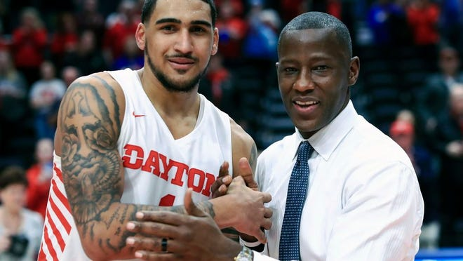 Dayton's Obi Toppin, left, celebrates scoring his 1,000th career point with head coach Anthony Grant after an NCAA college basketball game against Duquesne, in Dayton, Ohio. Toppin and Grant have claimed top honors from The Associated Press after leading the Flyers to a No. 3 final ranking. Toppin was voted the AP men's college basketball player of the year, Tuesday, March 24, 2020. Grant is the AP coach of the year.
