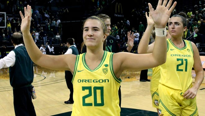 Oregon's Sabrina Ionescu acknowledges the crowd with teammates after an NCAA college basketball game against Texas Southern in Eugene, Ore. Ionescu capped off a unprecedented college career by entering an exclusive club. Oregon's star guard was a unanimous choice Monday, March 23, 2020, as The Associated Press women's basketball player of the year. She was only the second player ever to the lone recipient of votes, joining Breanna Stewart, since the award was first given in 1995.