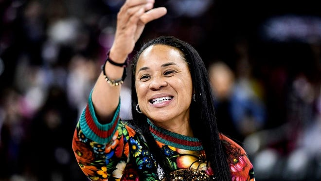 South Carolina head coach Dawn Staley participates in the school anthem after an NCAA college basketball game against Purdue in Columbia, S.C. The veteran Gamecocks coach was announced as The Associated Press women's basketball coach of the year Monday, March 23, 2020.