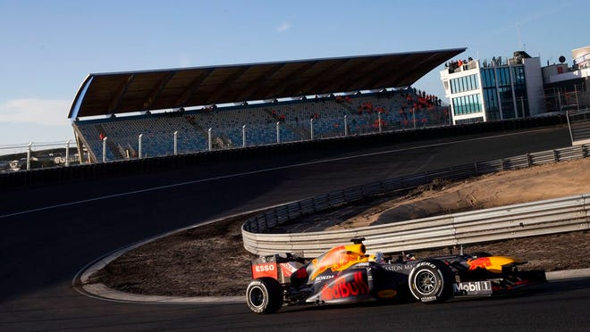 F1 driver Max Verstappen of The Netherlands drives his car through one of the two banked corners during a test and official presentation of the renovated F1 track in the beachside resort of Zandvoort, western Netherlands. The iconic Monaco Grand Prix was added Thursday to a growing list of Formula One races to be postponed because of the coronavirus outbreak. The first seven races of the Formula One season have now been postponed, with Netherlands and Spain joining Monaco as the latest to be called off. For most people, the new coronavirus causes only mild or moderate symptoms, such as fever and cough. For some, especially older adults and people with existing health problems, it can cause more severe illness, including pneumonia.
