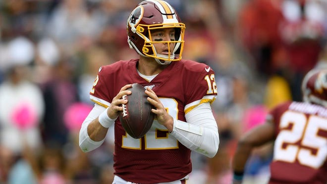 Washington Redskins quarterback Colt McCoy (12) looks to pass during the first half of an NFL football game against the New England Patriots, Sunday, Oct. 6, 2019, in Washington.
