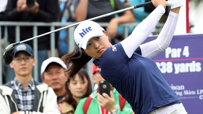From Oct. 31, 2019, Jin Young Ko of South Korea watches her tee shot on the first hole during the first round of the Taiwan Swinging Skirts LPGA tournament at the Miramar Golf Country Club in New Taipei City, Taiwan. Ko figures to be plenty rested whenever the LPGA Tour resumes. Ko left the CME Group Tour Championship in Naples, Florida, on Nov. 24 as the No. 1 player in women's golf, capping off her four-win, two-major season as the LPGA player of the year and winner of the Vare Trophy for lowest scoring average. The plan was to return for the Asia swing in mid-February and work her way into the season. She's still waiting.