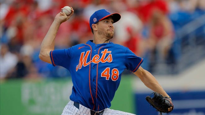 New York Mets pitcher Jacob deGrom throws to the St. Louis Cardinals during the second inning of a spring training baseball game, Wednesday, March 11, 2020, in Port S. Lucie, Fla.
