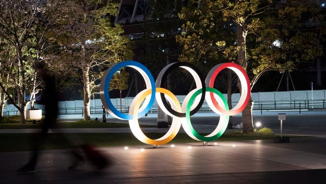 The Olympic rings are seen Monday, March 30, 2020, in Tokyo. The Tokyo Olympics will open next year in the same time slot scheduled for this year's games. Tokyo organizers said Monday the opening ceremony will take place on July 23, 2021.