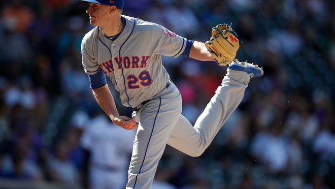 New York Mets relief pitcher Brad Brach (29) in the seventh inning of a baseball game Wednesday, Sept. 18, 2019, in Denver.