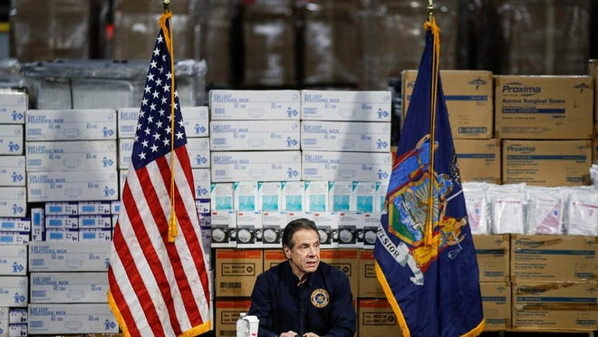 """FILE - In this Tuesday, March 24, 2020 file photo, Gov. Andrew Cuomo speaks during a news conference against a backdrop of medical supplies at the Jacob Javits Center that will house a temporary hospital in response to the COVID-19 outbreak in New York. Cuomo, a Democrat, ripped the GOP-led Senate's version of the coronavirus package as """"terrible"""" for New York and said, based on preliminary reports, that it would send the state some $4 billion in direct aid."""