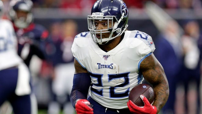 From Dec. 29, 2019, Tennessee Titans' Derrick Henry plays against the Houston Texans in an NFL football game in Houston. The Tennessee Titans have tagged Henry as their franchise player, making sure they keep the NFL rushing leader around for at least this season.