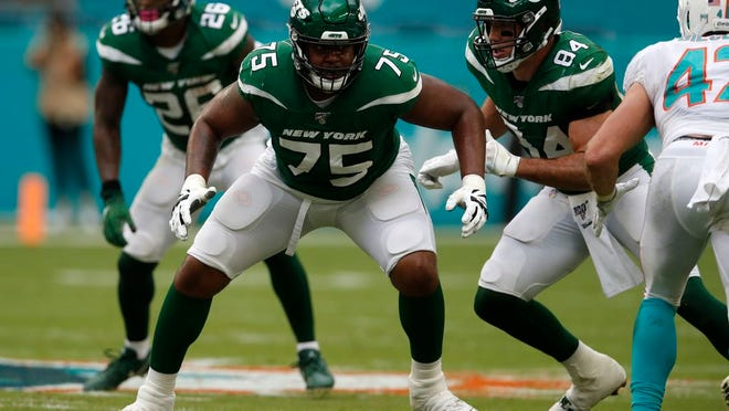 New York Jets offensive tackle Chuma Edoga (75) sets to block against the Miami Dolphins during an NFL football game, Sunday, Nov. 3, 2019, in Miami Gardens, Fla. The Dolphins won 26-18.