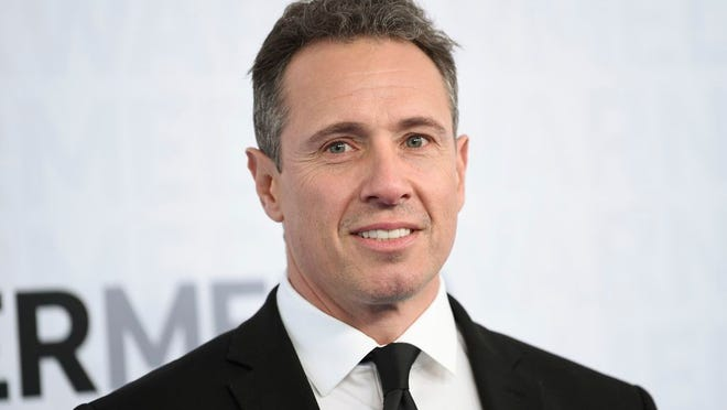 FILE - This May 15, 2019 file photo shows CNN news anchor Chris Cuomo at the WarnerMedia Upfront in New York. Cuomo has announced that he has tested positive for the coronavirus. The prime-time host is one of the most visible media figures to come down with the disease. He said he's experienced chills, fever and shortness of breath. He promised to continue doing his show while in quarantine in the basement of his home.