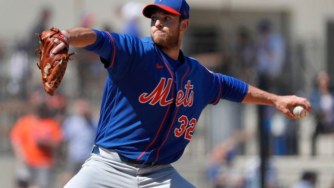 New York Mets pitcher Steven Matz throws during the first inning of a spring training baseball game against the Houston Astros Saturday, Feb. 29, 2020, in West Palm Beach, Fla.