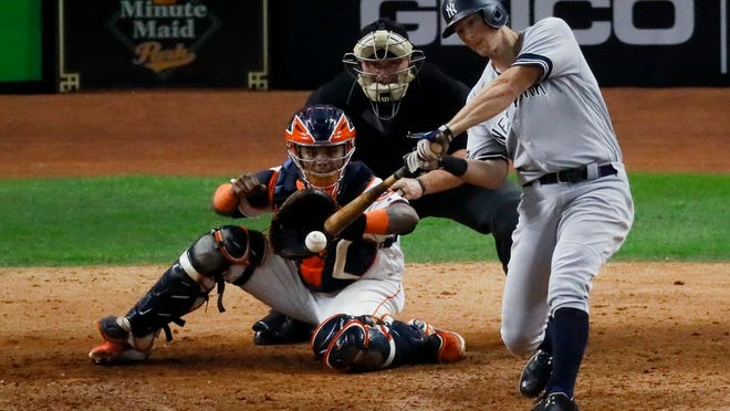New York Yankees' DJ LeMahieu hits a two-run home run against the Houston Astros during the ninth inning in Game 6 of baseball's American League Championship Series Saturday, Oct. 19, 2019, in Houston.