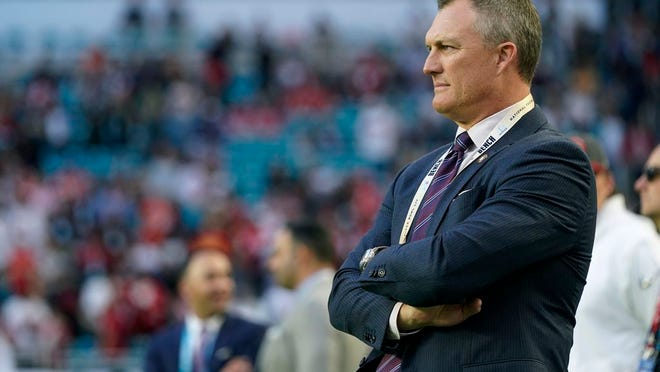 """From Feb. 2, 2020, San Francisco 49ers general manager John Lynch watches his team warm up for NFL football's Super Bowl 54 against the Kansas City Chiefs in Miami. """"You never stay the same,"""" Lynch said at the scouting combine. """"You're either getting better or getting worse. We're into getting better. It becomes trickier with less draft equity and things of that nature, but we've got a lot of good players that are part of us moving forward as well."""""""