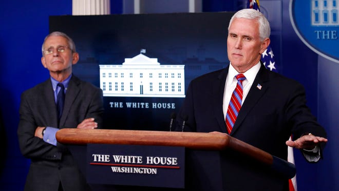 From April 13, 2020, Dr. Anthony Fauci, director of the National Institute of Allergy and Infectious Diseases, listens as Vice President Mike Pence speaks about the coronavirus in the James Brady Press Briefing Room at the White House in Washington. The commissioners of the major college football conferences held a 30-minute conference call Wednesday, April 15, 2020, with Vice President Mike Pence and stressed to him that college sports could not return from the coronavirus shutdown until college campuses have re-opened.