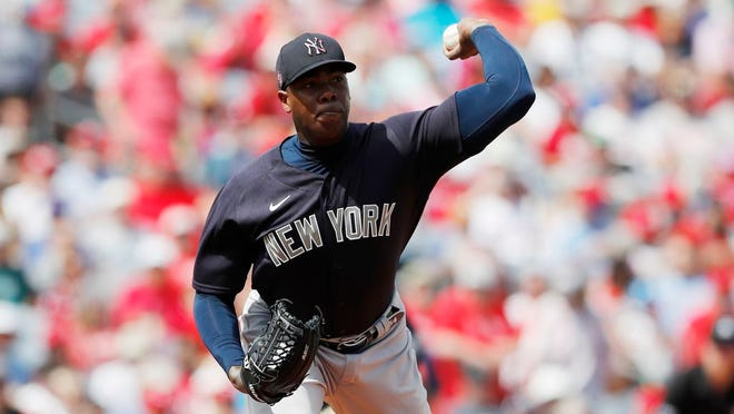 New York Yankees relief pitcher Aroldis Chapman throws to first during a spring training baseball game, Monday, March 9, 2020, in Clearwater, Fla.