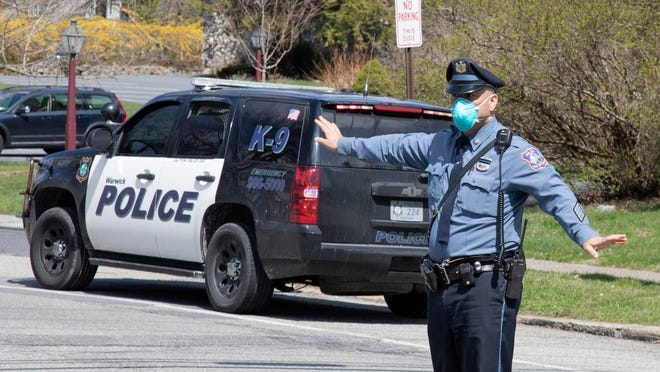 Warwick police direct traffic near St. Anthony Community Hospital during the COVID-19 pandemic on April 11, 2020 ROBERT G BREESE