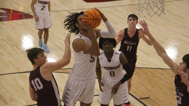 Ardmore's Anthony Jones flies to the basket during the first half Thursday night against Callisburg (Texas) at the Ardmore High School Gymnasium.