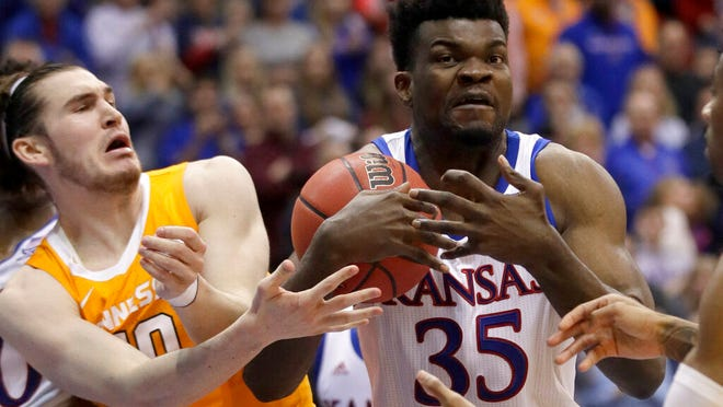 Kansas center Udoka Azubuike (35) rebounds against Tennessee forward John Fulkerson, left, during the second half of an NCAA college basketball game in Lawrence, Kan., Saturday, Jan. 25, 2020.