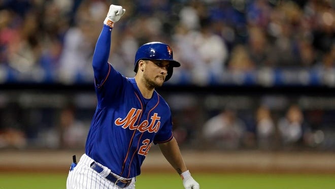 New York Mets' J.D. Davis celebrates after hitting a two-run home run during the fourth inning of a baseball game against the Atlanta Braves on Friday, Sept. 27, 2019, in New York.