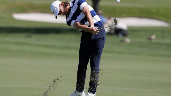 Tommy Fleetwood of England hits his second shot on the first hole during the third round of the Honda Classic golf tournament, Saturday, Feb. 29, 2020, in Palm Beach Gardens, Fla.