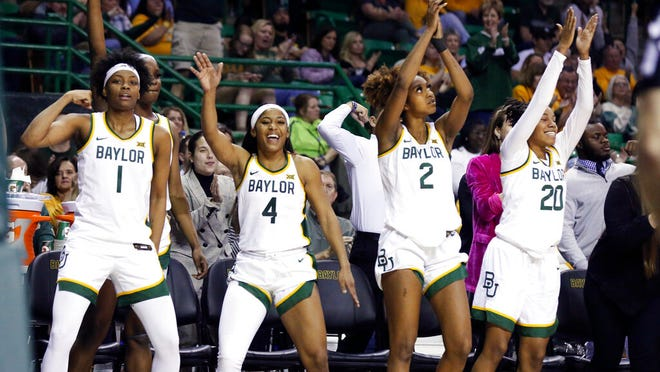 Baylor forward NaLyssa Smith, left, Te'a Cooper, DiDi Richards and Juicy Landrum celebrate at the end the second half of an NCAA college basketball game against Kansas State, Saturday, Feb. 29, 2020, in Waco, Texas.