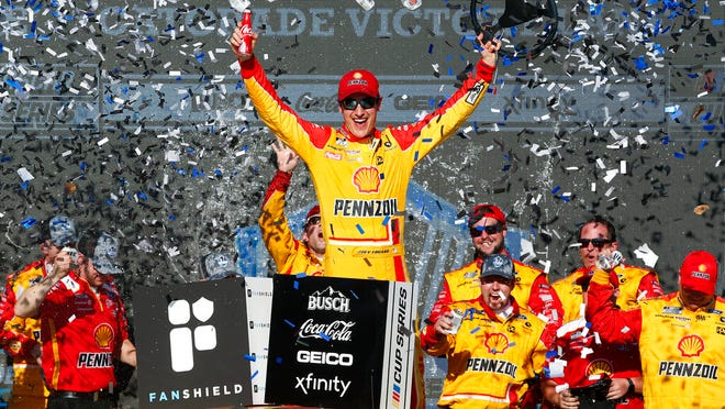 Joey Logano celebrates in Victory Lane after winning a NASCAR Cup Series auto race at Phoenix Raceway, Sunday, March 8, 2020, in Avondale, Ariz.