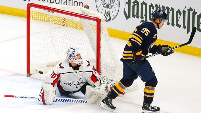 Buffalo Sabres forward Dominik Kahun (95) scores against Washington Capitals goalie Branden Holtby (70) during the shootout period of an NHL hockey game Monday, March 9, 2020, in Buffalo, N.Y.