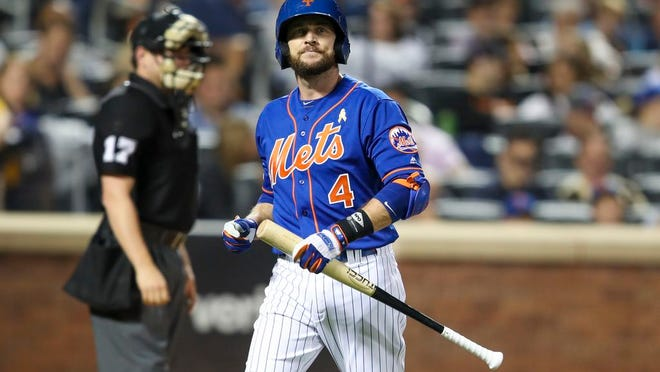 New York Mets' Jed Lowrie reacts after striking out during the fourth inning of a baseball game against the Philadelphia Phillies, Saturday, Sept. 7, 2019, in New York.