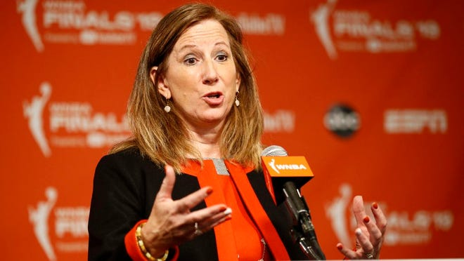 """From Sept. 29, 2019, WNBA Commissioner Cathy Engelbert speaks at a news conference before Game 1 of basketball's WNBA Finals between the Connecticut Sun and the Washington Mystics, in Washington. The WNBA draft will be a virtual event this year. The league announced Thursday, March 26, 2020, that its draft will still be held April 17 as originally scheduled, but without players, fans or media in attendance due to the coronavirus pandemic. """"The WNBA draft is a time to celebrate the exceptional athletes whose hard work and dreams are realized with their selections in the draft,"""" WNBA Commissioner Cathy Engelbert said."""
